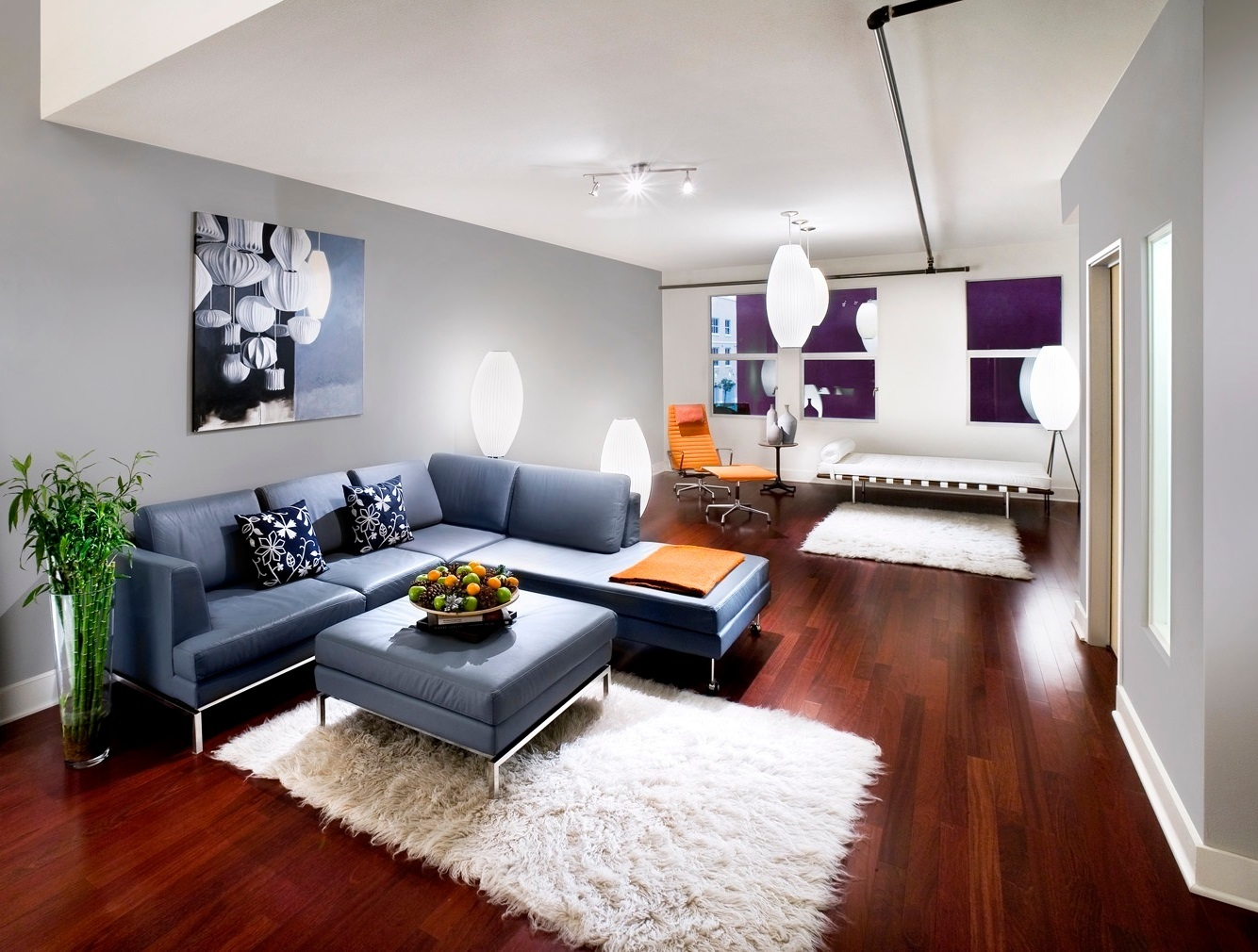 living-room-interior-awesome-l-shaped-cadet-blue-leather-sofa-with-track-arm-and-stainless-steel-frame-includes-the-right-side-chaise-also-squre-cadet-blue-leather-ottoman-coffee-t